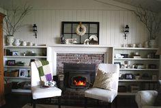 Fireplace, shelving, white walls & white room