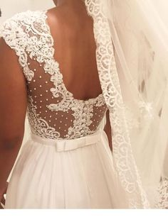 I really like this wedding dress back with lace and bow