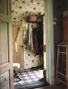 I love the floor and wallpaper and green trimming. Just lovely!
