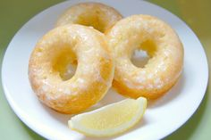 """Baked Lemon Donuts.  These donuts are light and fluffy and """"dressed"""" with a lemon glaze. Also, because these donuts are baked, and are also packed with lemon zest and Greek yogurt, they are a nice alternative to the dense, chocolate-focused, store-bought donuts I am accustomed to!"""