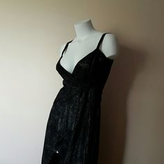 Genuine Leather Wrap-Around Dress by Bebe ❤️👗 Black genuine leather with silver glitters.  Designed with patchwork with leather top stitch. Beautiful and excellent condition. bebe Dresses High Low