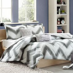 Give your bedroom a unique, modern look with the Chevron comforter set. Printed on luxurious Cozy Soft fabric, this set features an eye-catching chevron print in a contemporary palette of grey and white.
