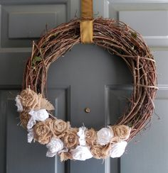 Burlap on Grapevine Wreath with Large Burlap Bow - Natural Burlap Roses, Pearls, and White Lace - Rustic Wedding Decoration. $44.00, via Etsy.