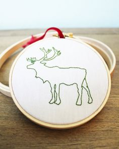 This embroidered moose ornament on Etsy donates 50% to support Feeding America