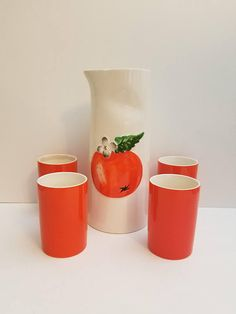 Mid century Holt-Howard orange and white ceramic decanter set