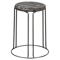 Distressed pine and iron stool.   Product: StoolConstruction Material: Pine and ironColor: Distressed ...