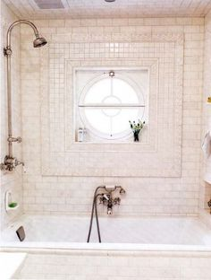 white tiled bath