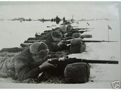The Mosin Nagant also saw service in Estonia after WW2 as a part of the Soviet Union.  In the photo are Soviet (Estonian) soldiers in training.  Notice the second rifle which has a bent bolt of some sort but does not appear to be a sniper rifle.