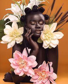Dark skinned woman flowers.