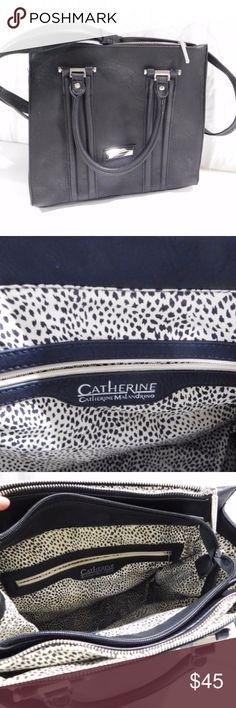 "Catherine Malandrino Silver & Black Handbag Very sophisticated Catherine Malandrino Silver & Black Handbag. Shell: 100% Polyurethane  - Lining 100% Polyester Measurements: Length: 13"", Width: 5"", Height: 11"", Drop: 15"", Handles: 7"" Catherine Malandrino Bags Shoulder Bags"