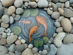 painting a water scene including koi, lily pads, and a dragonfly on slate.