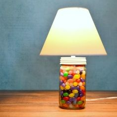 Make a lamp from a mason jar full of jellybeans with this 2-minute tutorial. No drilling or wiring required!