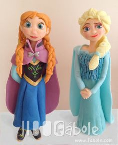 Anna and Elsa from Frozen, made in Fondant. www.facebook.com/fabolecaketoppers.com