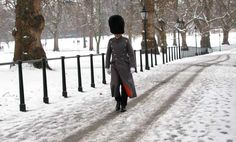 A lone soldier marches through snow on Green Park in London, Sunday, Feb. 5, 2012. Snowfall and freezing weather conditions across the country are causing disruption to transport, with snow falling across much of Britain. (AP Photo/Kirsty Wigglesworth)