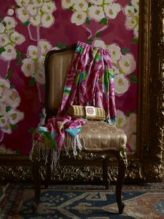 love that thickly painted floral on the wall contrasting with the brighter floral scarf