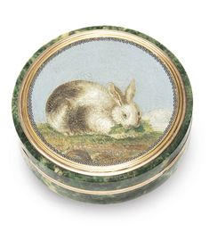 An Italian gold, micromosaic and hardstone snuff box, circa 1800 circular, the cover with fine mosaic of a rabbit eating lettuce, within gold border, mottled green marble body apparently unmarked