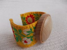 EThnic Adjustable textile bracelet with wooden pendant, new style jewelry, yellow, textile bangle,cuff bangle bracelet, wooden cuff bracelet  https://www.etsy.com/listing/263791680/ethnic-adjustable-textile-bracelet-with?ref=shop_home_active_7