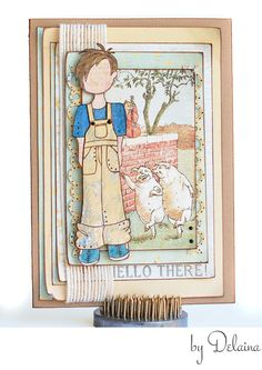 """Hello There! Moving right along we have a sweet sample by Delaina featuring a """"down-on-the-farm"""" card filled with rustic character! From Toby's worn overalls...to the messed-up boyish hair (achieved with new watercolor pencils applied dry), this whole card has us simply loving the country life!"""