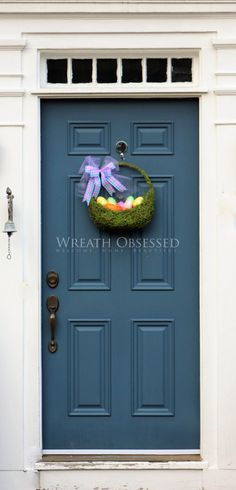 Moss Easter Basket Door Hanger by WreathObsessed Lovely Moss Easter Basket filled with Pastel Easter Eggs. This Easter Decoration brightens up the entry area and welcomes guests as cheerful Indoor / Front Door Decor decoration. This Easter Decoration may used as both door decor or wall decor to celebrate Easter and Welcome in Spring. Wreath Obsessed - Welcome. Home. Beautiful.