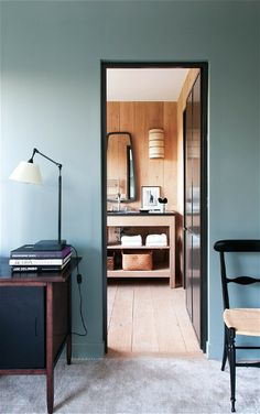 Blue wall, black door frame, black chair. Interior paint color inspiration #blue #interior #color more on www.benedict.be