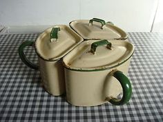 A wonderful three piece enamel ware... handled canister set... cream and jadeite green. UK location.