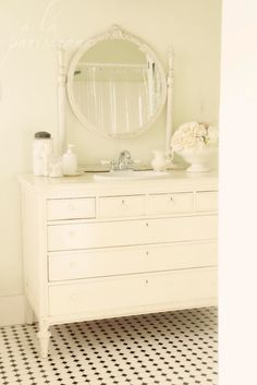 I love the idea of using an antique dresser for the vanity!