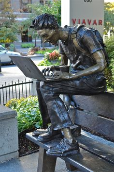 Closer view of the statue of a MacGill College student - Montreal, Quebec, Canada