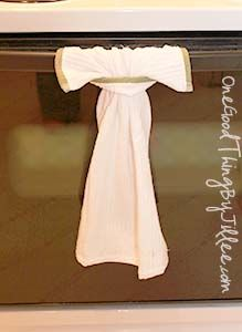 """A Simple Hanging Dish Towel {That Actually Stays Put!}  a dish towel of your choosing. (I just grabbed some very basic ones at Walmart)  the ability to sew an XXL """"button hole"""" onto the towel  a pair of scissors"""