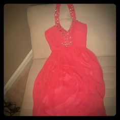 Coral prom dress  sz 1/2 by Bee Darlin from macys Coral sequins and beaded halter style formal dress , looks beautiful .High waist with long pleats making it flow .zips in the back and clips behind the neck ,built in padding for extra support and push.Worn once. Bee Darlin  Dresses Prom