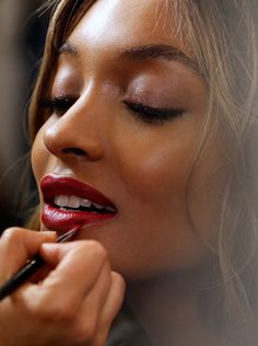 Backstage at the Prorsum Show - Jourdan Dunn wearing the tawny eye & bold lip from the Burberry beauty look