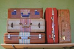 use paint and fabric to spruce up old suitcases