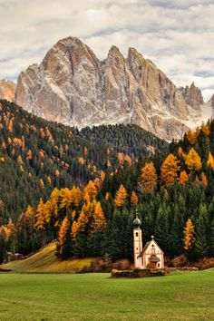 For a few shorts weeks in the fall, the trees match this tiny church in the Italian Alps.
