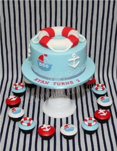 Nautical Themed Cake & Cupcakes - OMG this is so super cute...this would have been perfect for the boys baby shower...totally their theme since they were babies...Gabi, I so want these for their next bday!