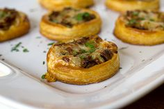 Cheesy tartlets with mushrooms and caramelized onions on a bed of puff pastry. Thinking of using frozen pastry shells and doing this for our upcoming studio party--classy finger food!