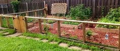 My garden made completely out of reclaimed wood. I have 4 blueberry bushes, 2 raspberry bushes, 2 Concord grape vines, 6 types of tomatoes, 2 strawberry patches, a watermelon patch, cucumbers, seedless watermelons, peppers, peas, beans, lettuce, and an herb garden.