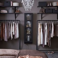 An open wardrobe consisting of hanging racks, open shelves and a display cabinet, filled with clothes and boxes. An open wardrobe consisting of hanging racks, open shelves and a display cabinet, filled with clothes and boxes. Wardrobe Storage, Clothing Storage, Armoire Wardrobe, Clothing Racks, Storage Room, Walk In Wardrobe, Wardrobe Design, Ikea Open Wardrobe, Open Closets