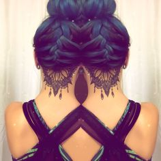 Seeing double undercut tattoo sunflower mandala blue hair braided bun Más More