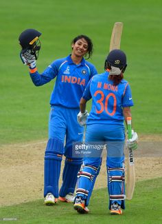 India batsman Smriti Mandhana celebrates her century with Mona Meshram during the ICC Women's World Cup 2017 match between West Indies and India at The County Ground on June 29, 2017 in Taunton, England.