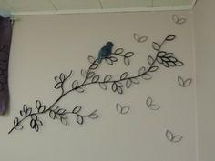 Bloementak van wcrolletjes voor aan de muur.