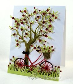 Paper:  White, Red, Spring Moss, Kraft      Accessories:  Memory Box Grand Oak Tree, Brand New Bicycle, Flower Mound, My Favorite Things Fresh Cut Grass, Martha Stewart Branch Punch, Glossy Accents , Mounting Tape , Stylus , Mat, Metal Adapter Plate , Glue Dots , Paper Piercer , ATG , Big Shot, Teflon Bone Folder, White Organdy Ribbon, Snips, Distress Markers