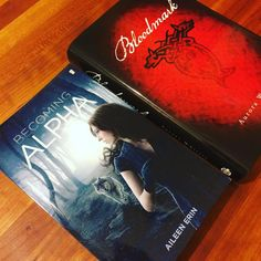 """Werewolves make great stocking stuffers for Christmas! """"Becoming Alpha"""" by Aileen Erin and """"Bloodmark"""" by Aurora Whittet."""