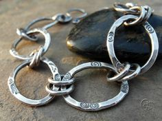 All silver chain bracelet, made to order in your size. Each ring is created from thick gauge) pure silver wire. Cut, forged and fused by hand. Fusing occurs when the metal is heated to a point of Steel Jewelry, Wire Jewelry, Beaded Jewelry, Silver Bracelets, Bangle Bracelets, Bangles, Silver Rings, Come Undone, Handmade Bracelets