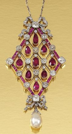 RUBY, PEARL AND DIAMOND PENDANT NECKLACE, CIRCA 1910. The open work lozenge-shaped pendant designed as a knife-edge lattice millegrain-set with circular-, single-cut and cushion-shaped diamonds and articulated pear-shaped rubies, suspending a diamond capped pearl drop, embellished by two tied ribbon motifs highlighted by rose- and single-cut diamonds, to a fine curb and fetter link chain, length approximately 464mm. #EdwardianRubyPendant