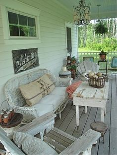 "need porch ideas....my little wicker loveseat is alreay ""country chic"" if this is what country chic looks like. :-D"