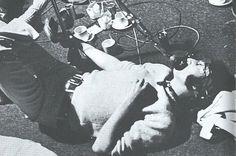 John recording vocals for Revolution whilst lying on the floor, 1968.