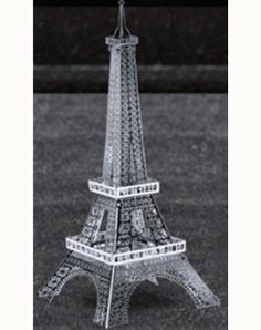 "Metal Marvels - Eiffel Tower by American Science & Surplus. $5.04. Magnificent Metal Mini-Model We spit on plastic. And so will you when you see this laser-cut bright steel Metal Marvels"" model of the Eiffel Tower from Fascinations®. Snap-together pieces. The models are small, but worthy of permanent display, and designed for the grown-ups to assemble and display, rather than the kids to play with. It's 4-1/2"" tall x 1-3/4"" wide at the base when completed."
