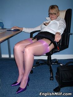 English MILF - Secretary in purple nylon stockings and heels in the office.