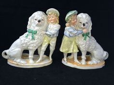 Antique porcelain pair of dogs with boy and girl . Marked  #staffordshire #Germany