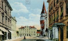 An old postcard of the railway station in front, Celje Hall on the right, and the Iron Court (Železni dvor, Eisenhof) on the far left