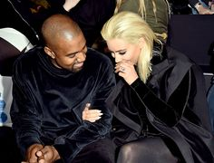 After she debuted platinum blonde hair Thursday morning, March 5, Kim Kardashian joined husband Kanye West at the Balmain fashion show, where two were majorly affectionate; see the sweet photos and video here
